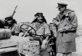 Sir-David-Stirling-founder-of-the-SAS-with-Duffle-Coat-in-the-Desert-600x412